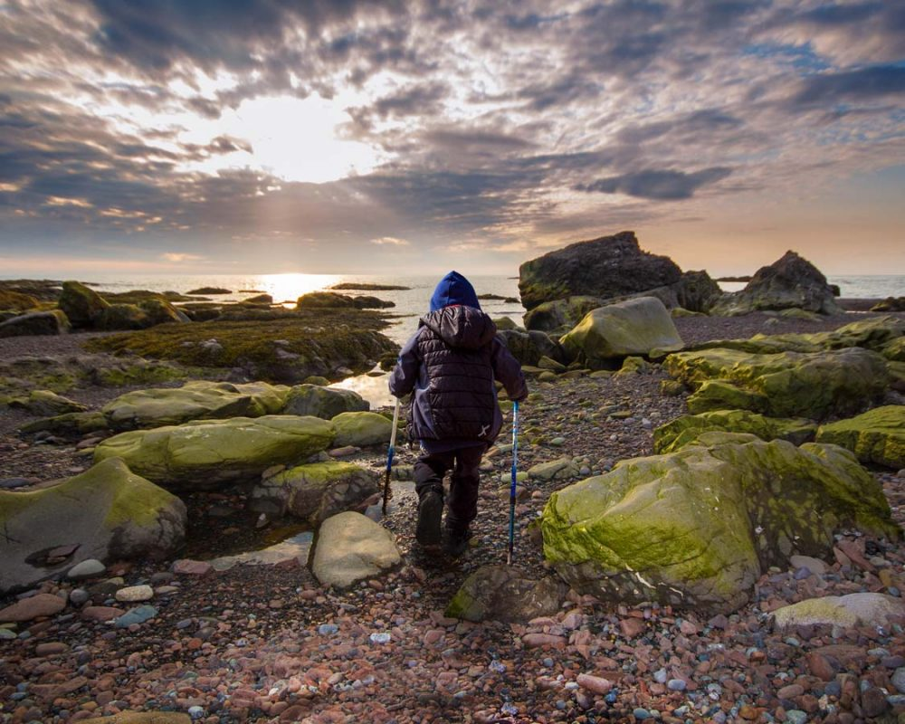 Young boy hiking the Green Gardens Trail in Gros Morne National Park