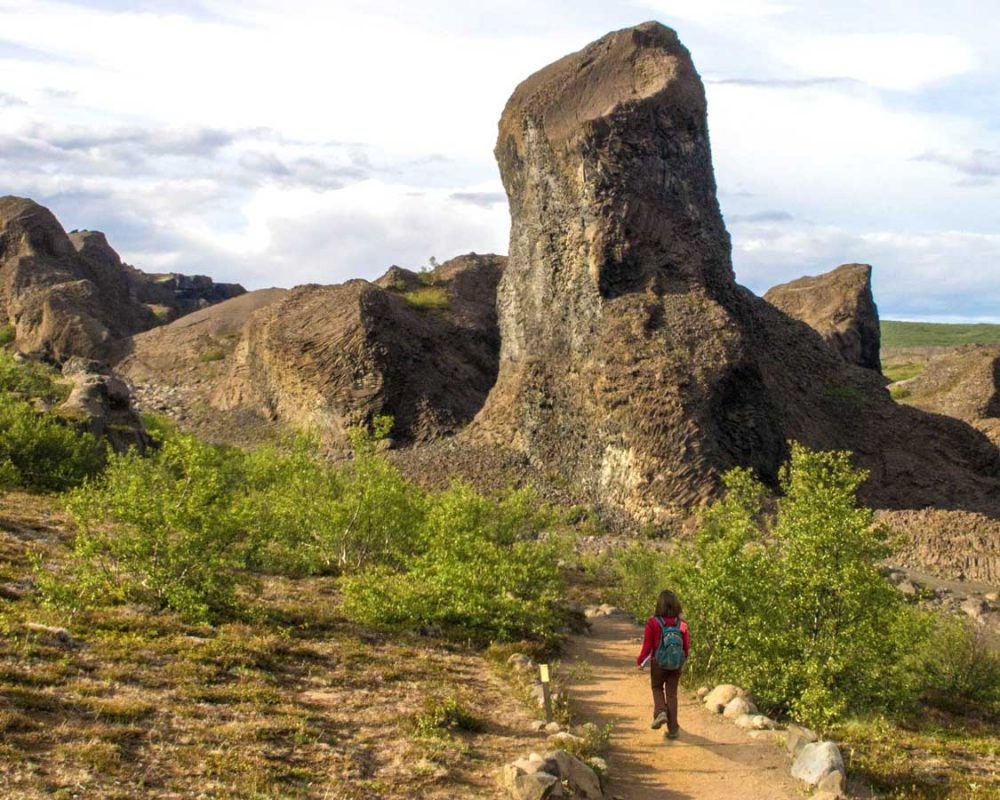 Woman hiking in Dimmoborgir, Iceland