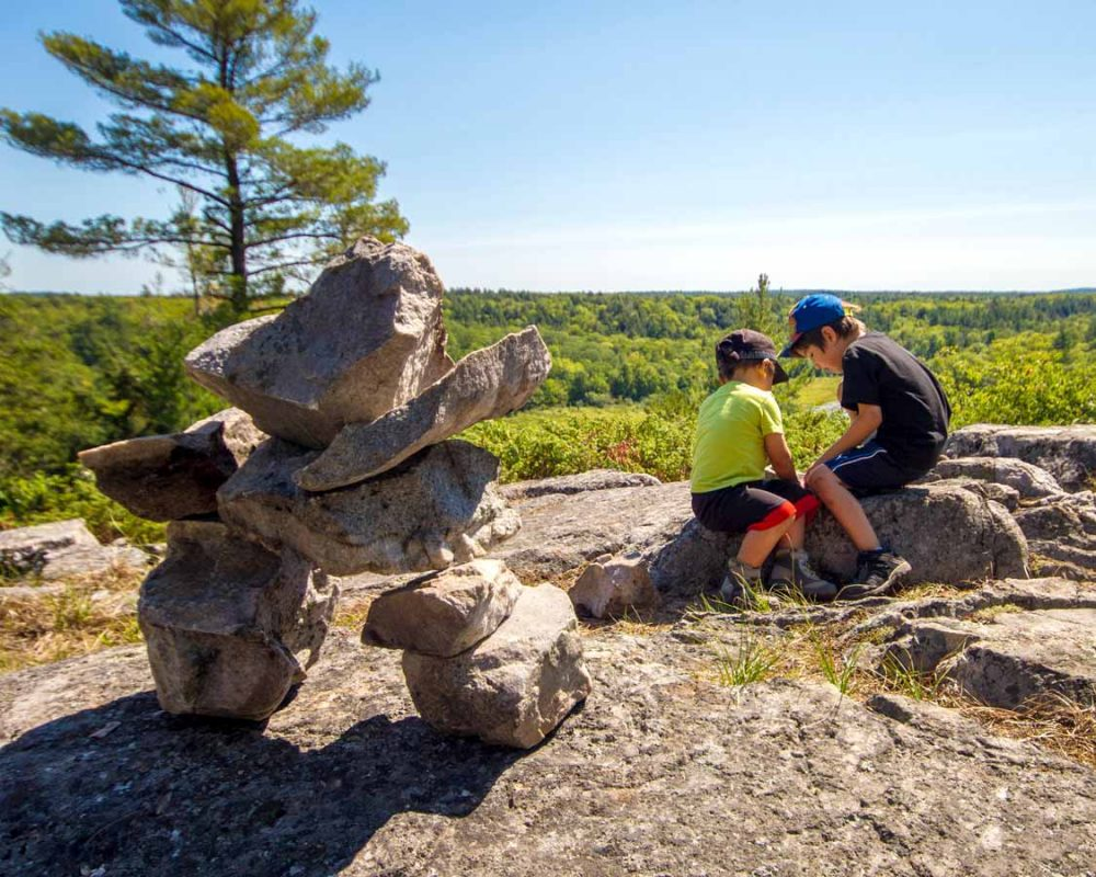Tips for hiking with kids playing with rock
